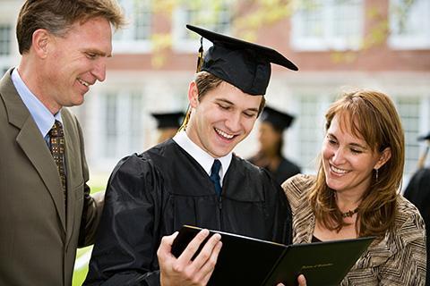 Graduation: Proud Family Admires Diploma